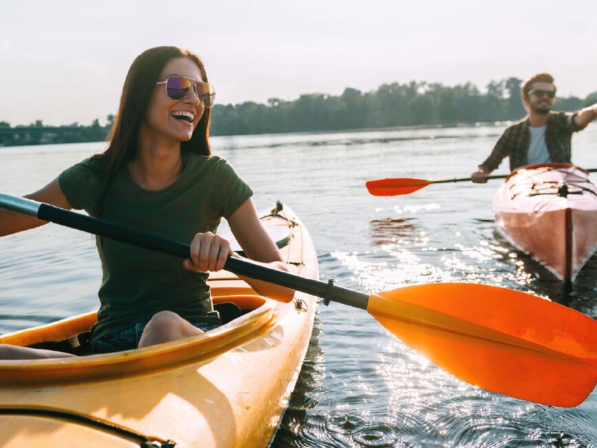 couple rowing on lake