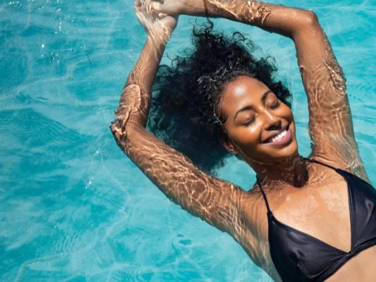 woman-floating-in-pool