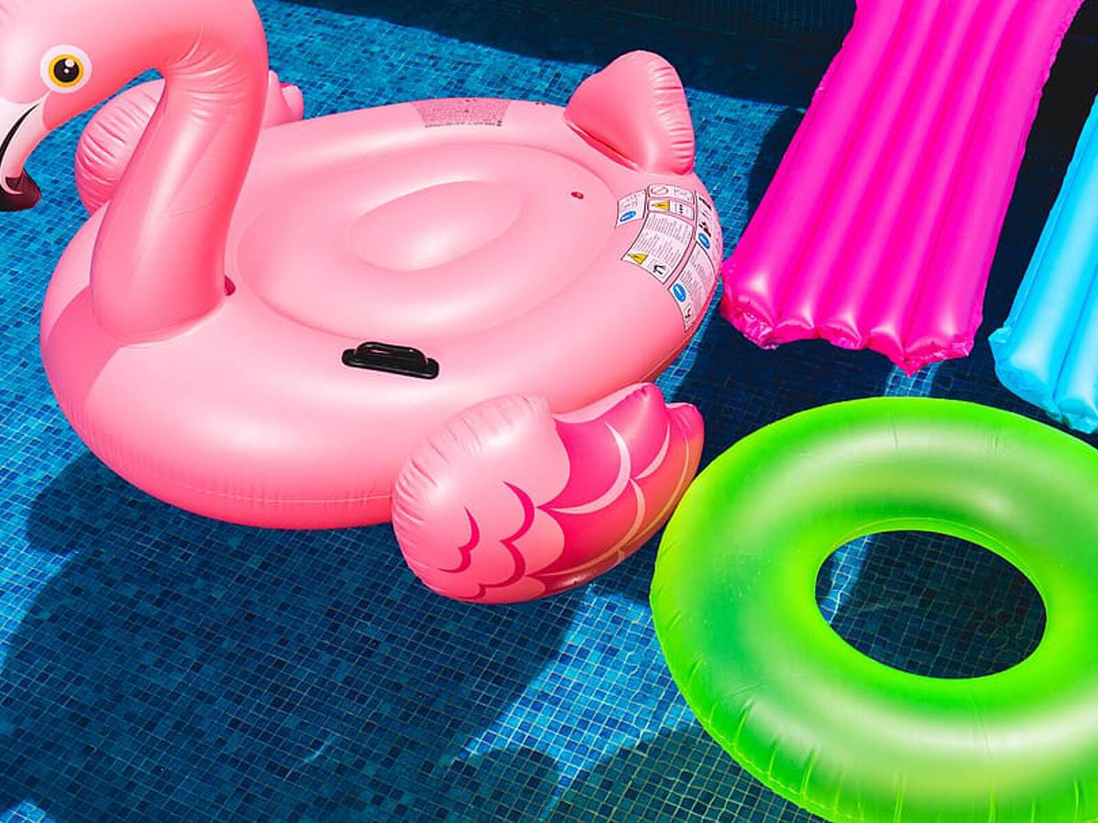 flamingo & circular floats in the  pool at The Inn of Waterloo