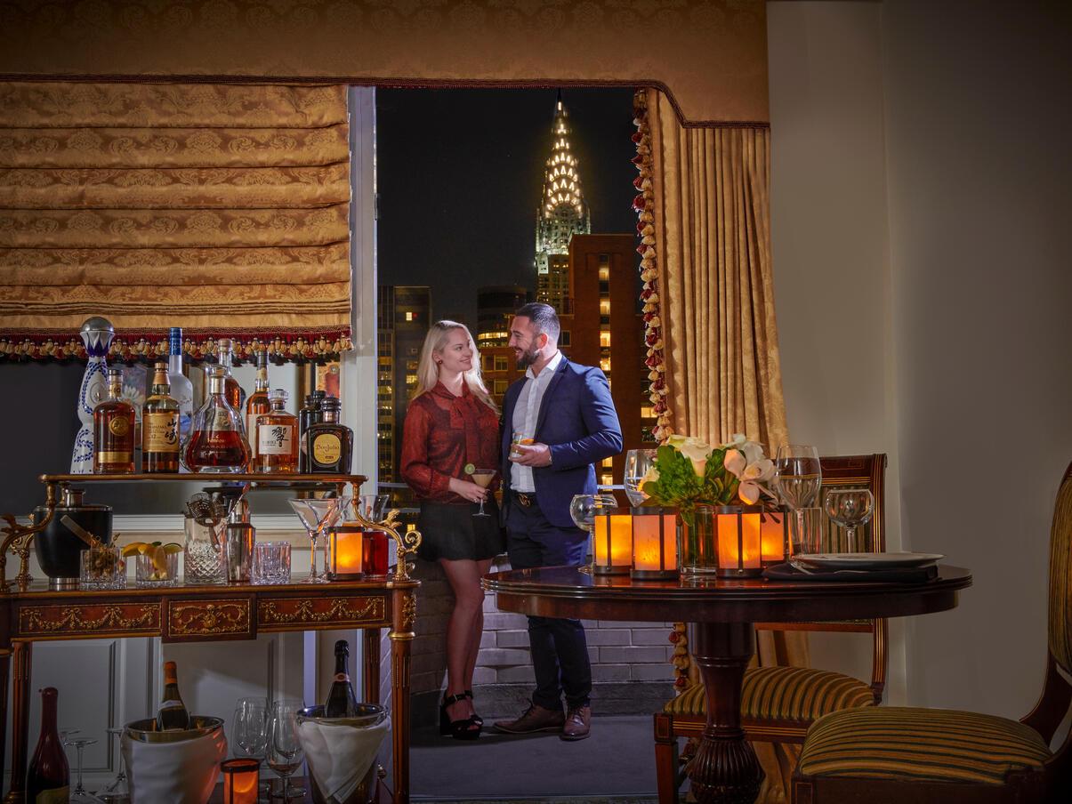 A couple near a bar at Kimberly Hotel