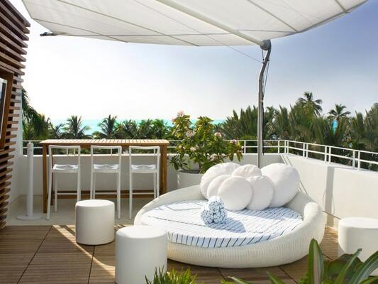 Private Rooftop cabana with sofabed at Dream South Beach