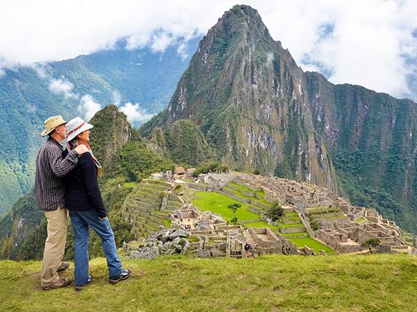 A couple enjoying the scenery of the mountains near Hotel Sumaq