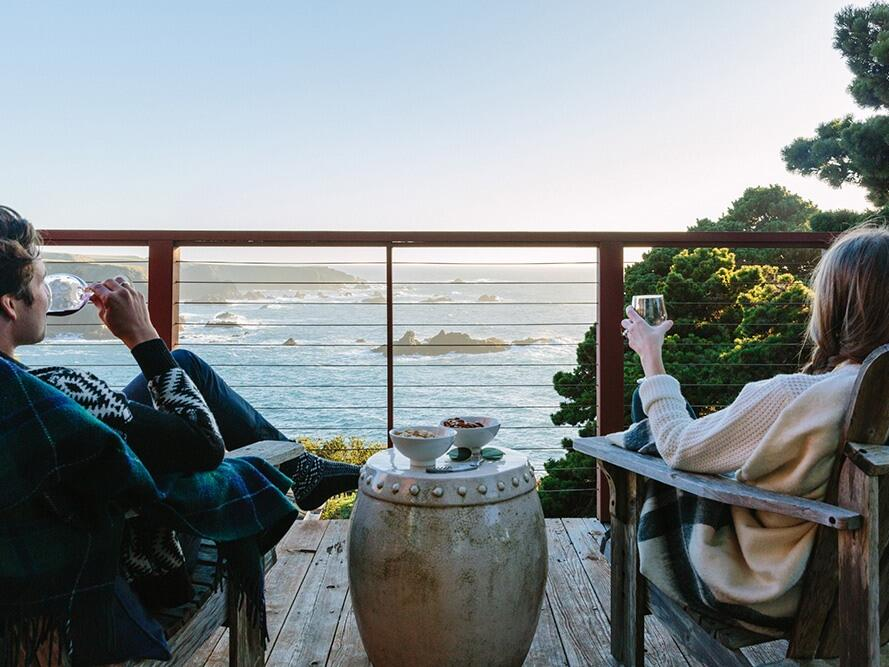 Couple enjoying the views on a balcony at Heritage House Resort