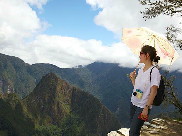 A tourist in Machu Picchu mountains