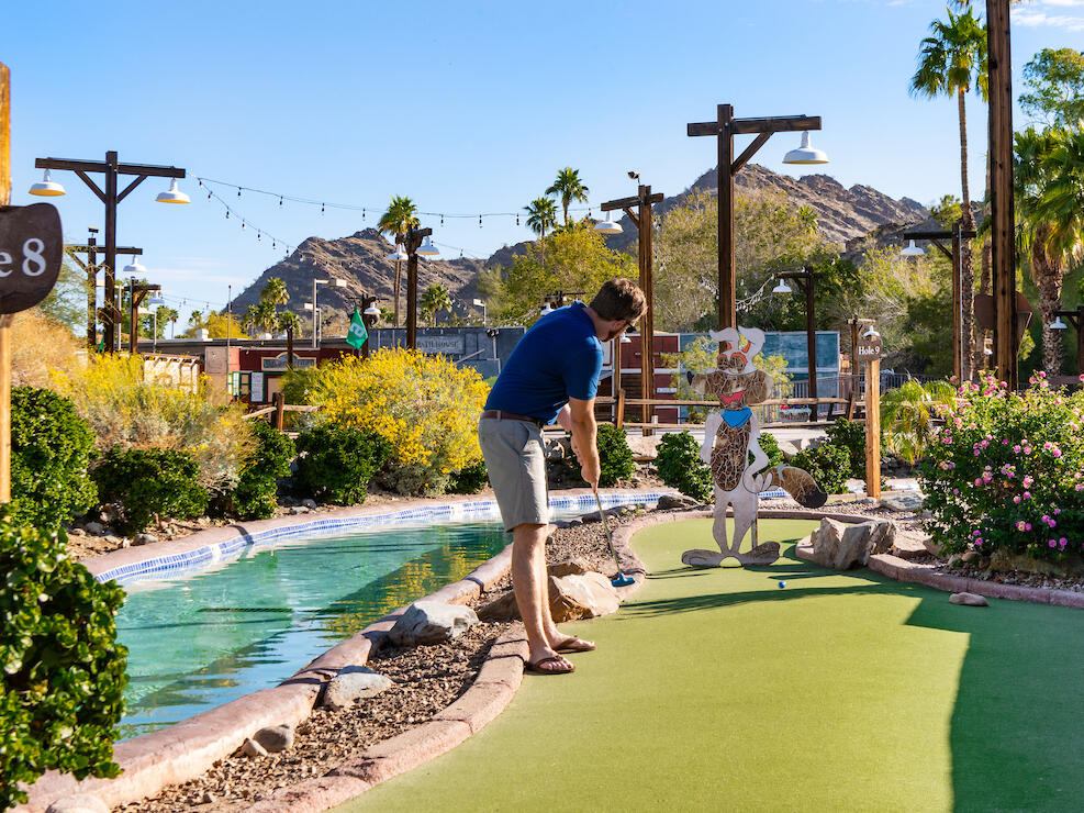 Adult playing putt putt at River Ranch Water park