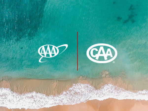 View of AAA and CAA logos with the sea background