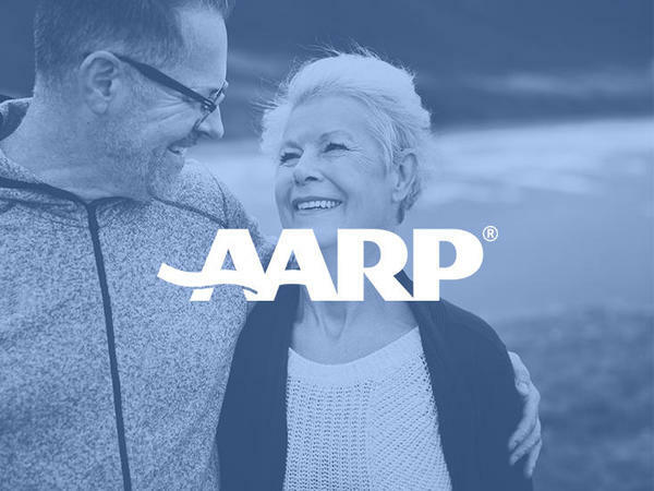 View of the AARP logo with the couple