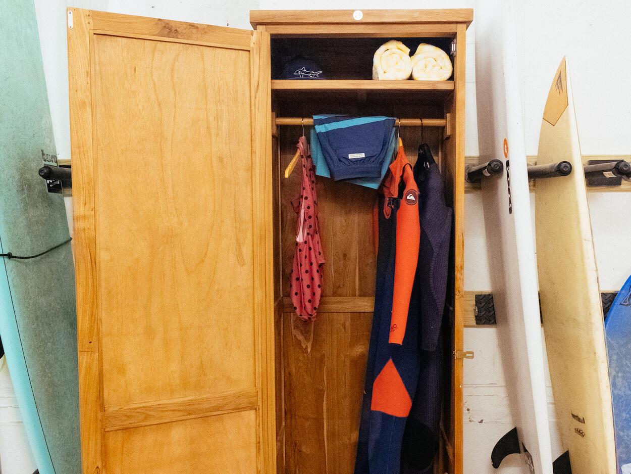 Surfing boards near a cupboard at The Rockaway Hotel
