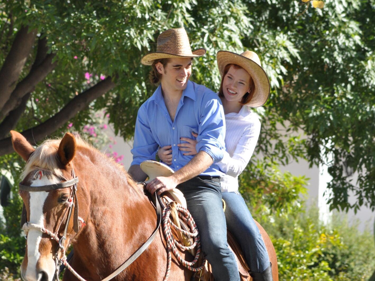Couple enjoying a horse ride near Hacienda Cantalagua