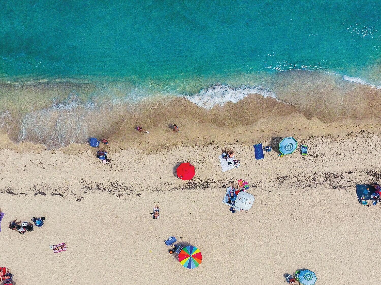 Aerial view of sunbeds & umbrellas at Dream South Beach