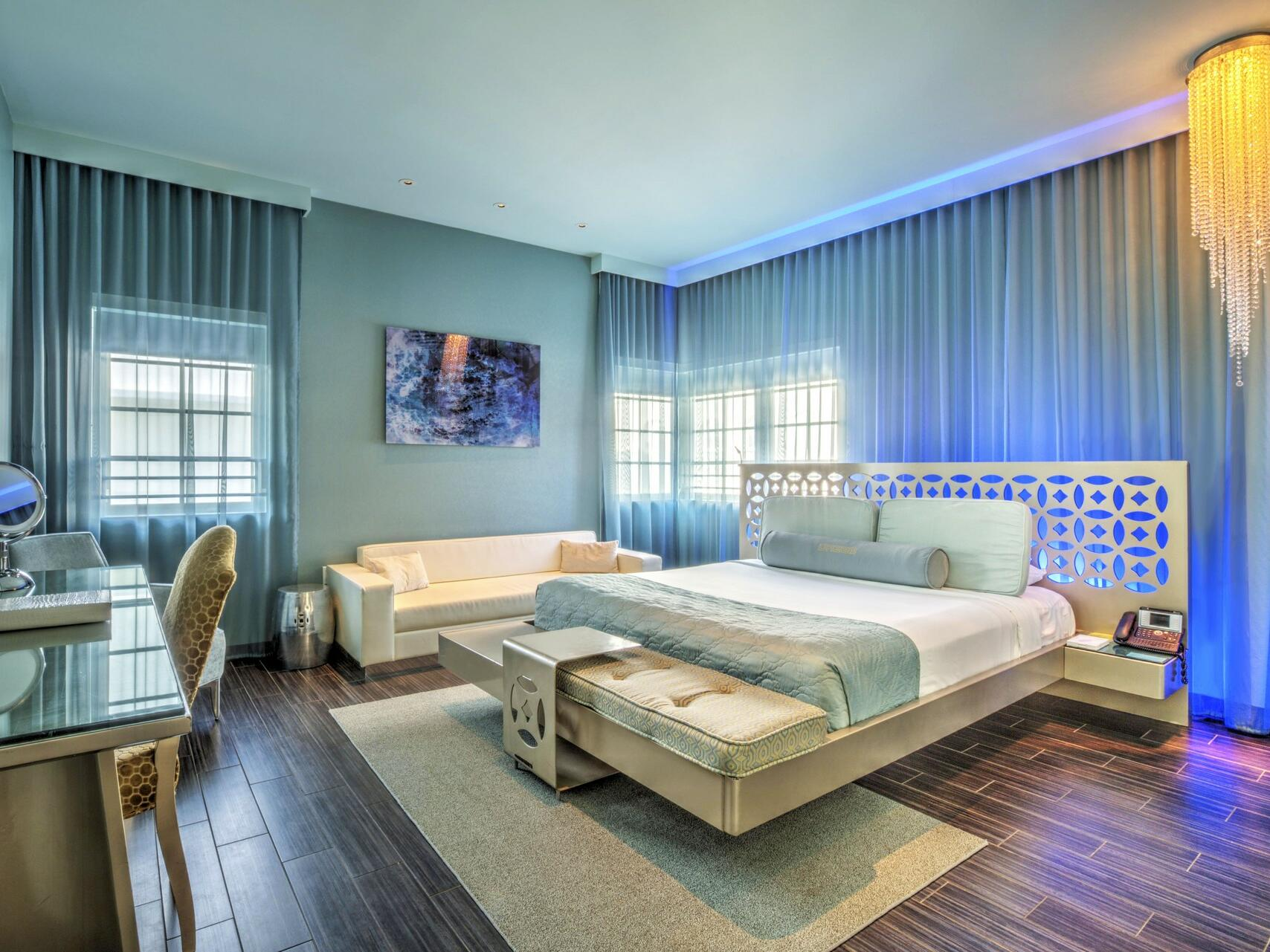Gold Junior Suite bedroom with a king bed at Dream South Beach