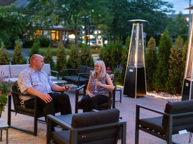 Couple having drinks on the patio