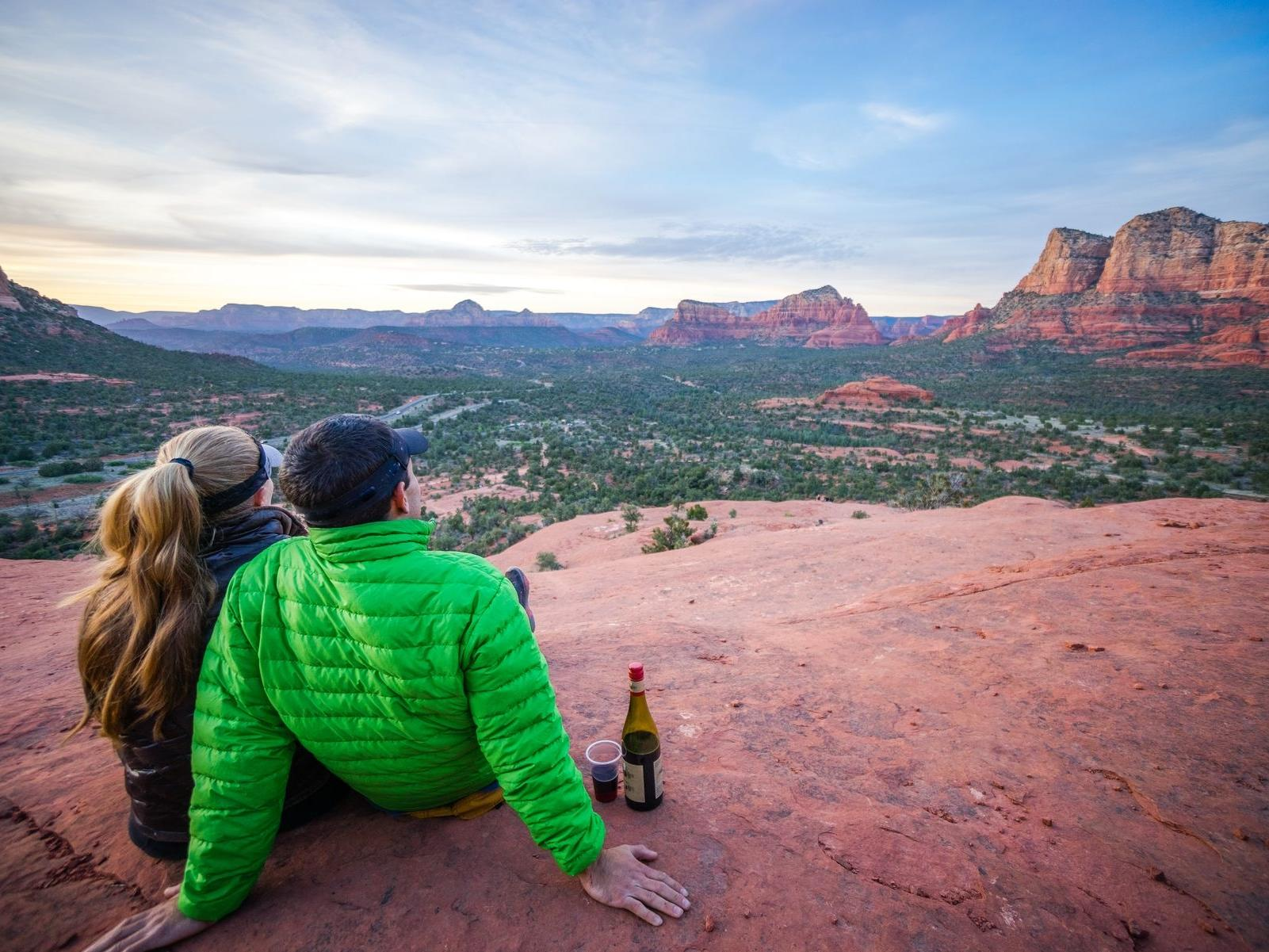 A couple enjoying the view of a beautiful landscape