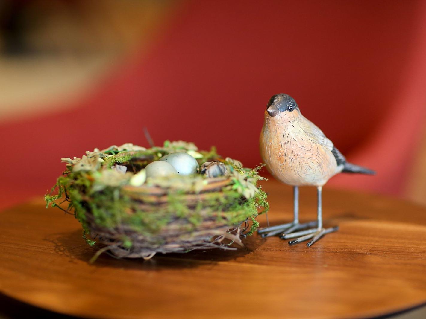 Small bird-and-nest sculpture.