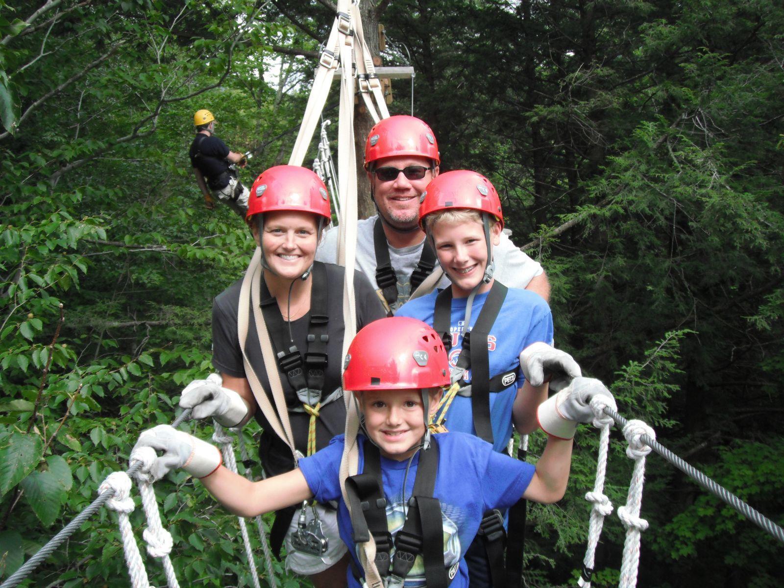 Family on a long rope bridge.