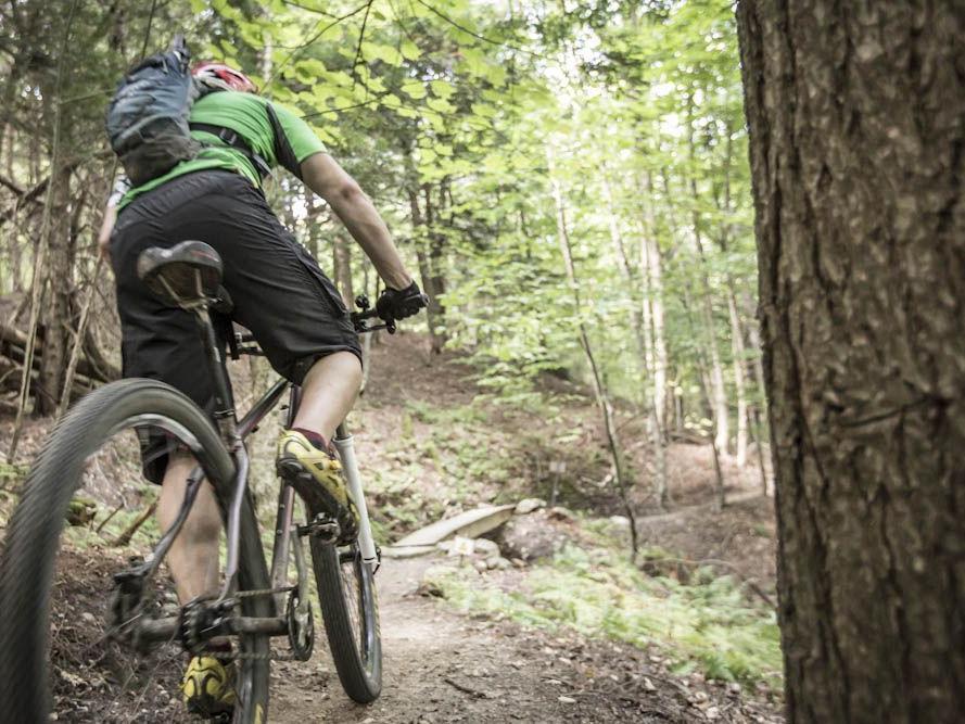 Man mountain biking through the hills of Vermont.
