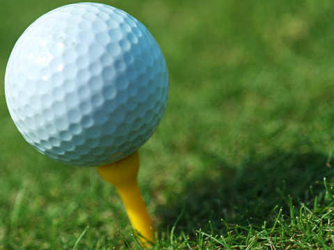 Close photo of golf ball on tee.