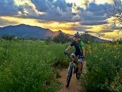 Cycling through sunset mountains in Arizona