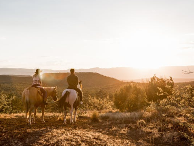 Two people horse riding at Diamond ranch