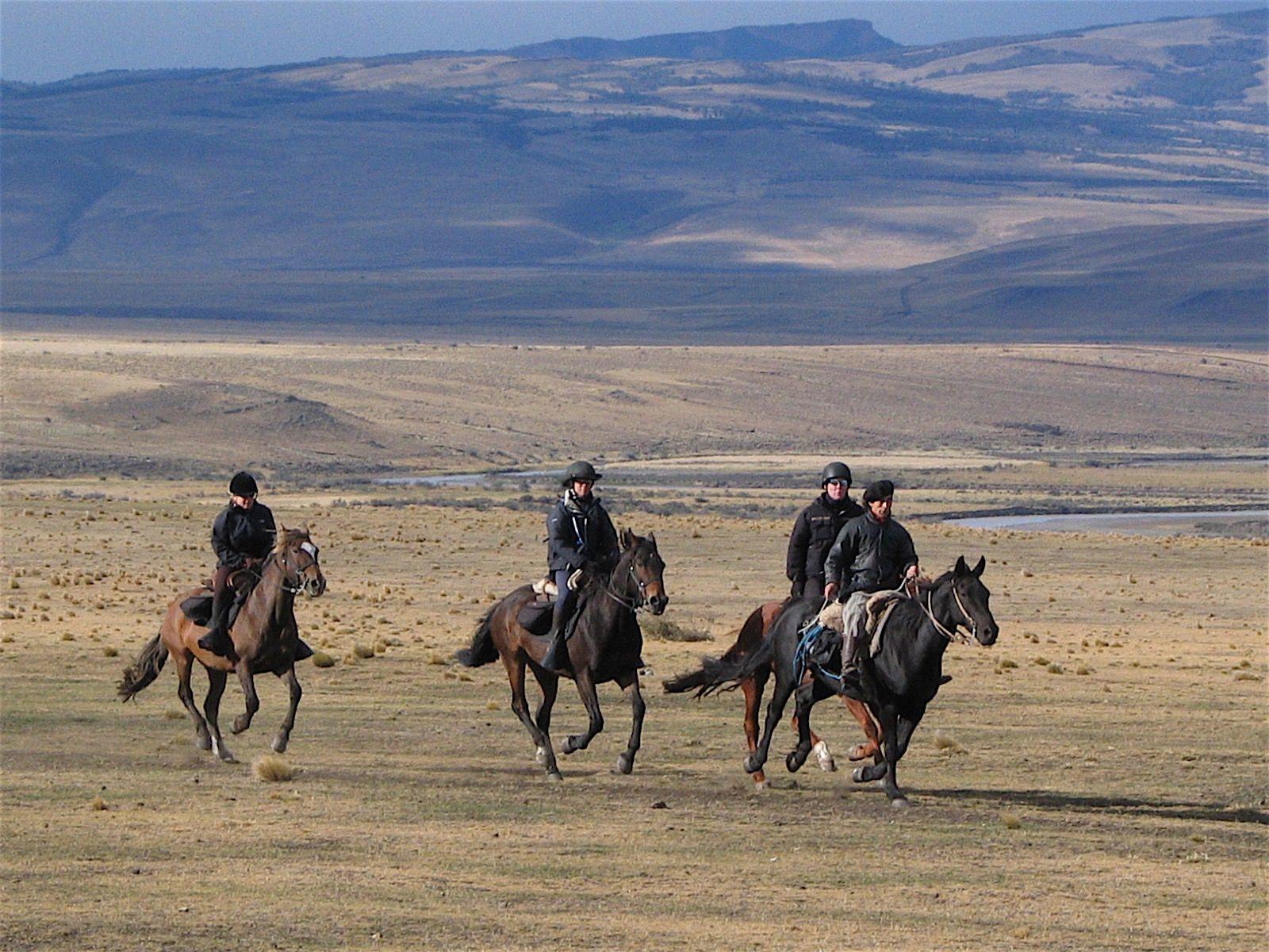 4 men on horses at the Estancia near NOI Indigo Patagonia
