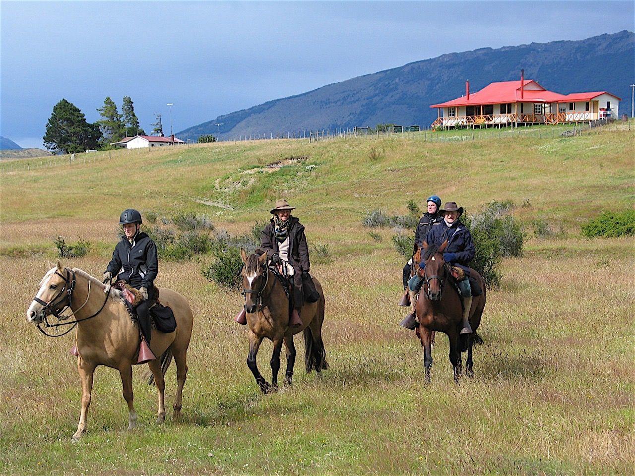 4 men on horses at Sofia Lake Horseback Ride near NOI Indigo