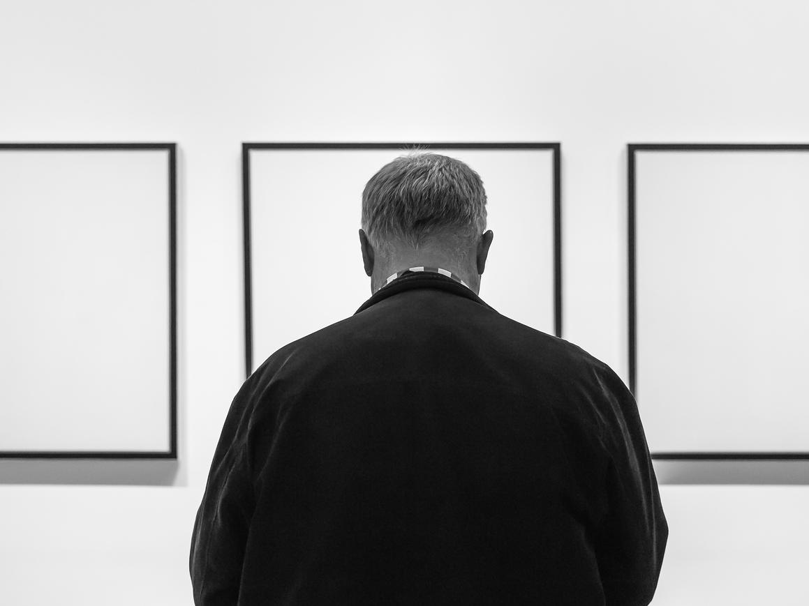 Guest in front of MoMA Exhibit