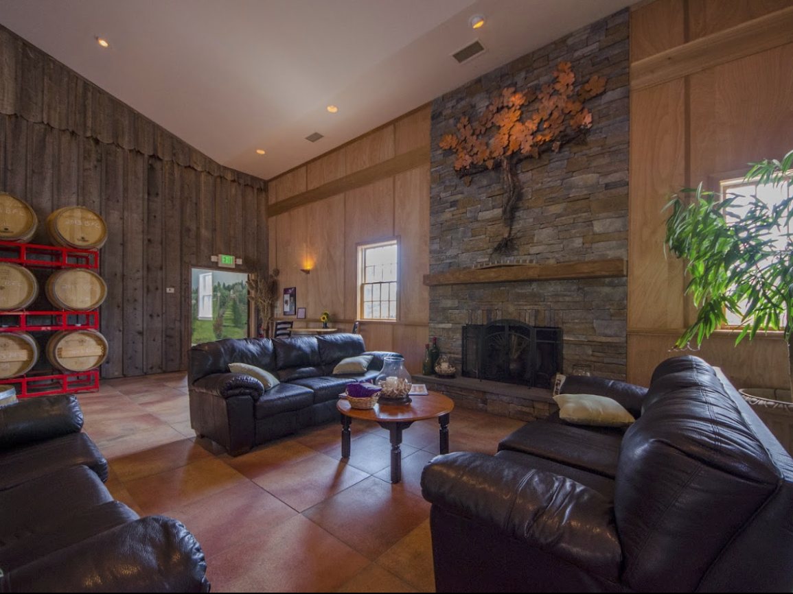 wood and brick lined room with fireplace and sofa