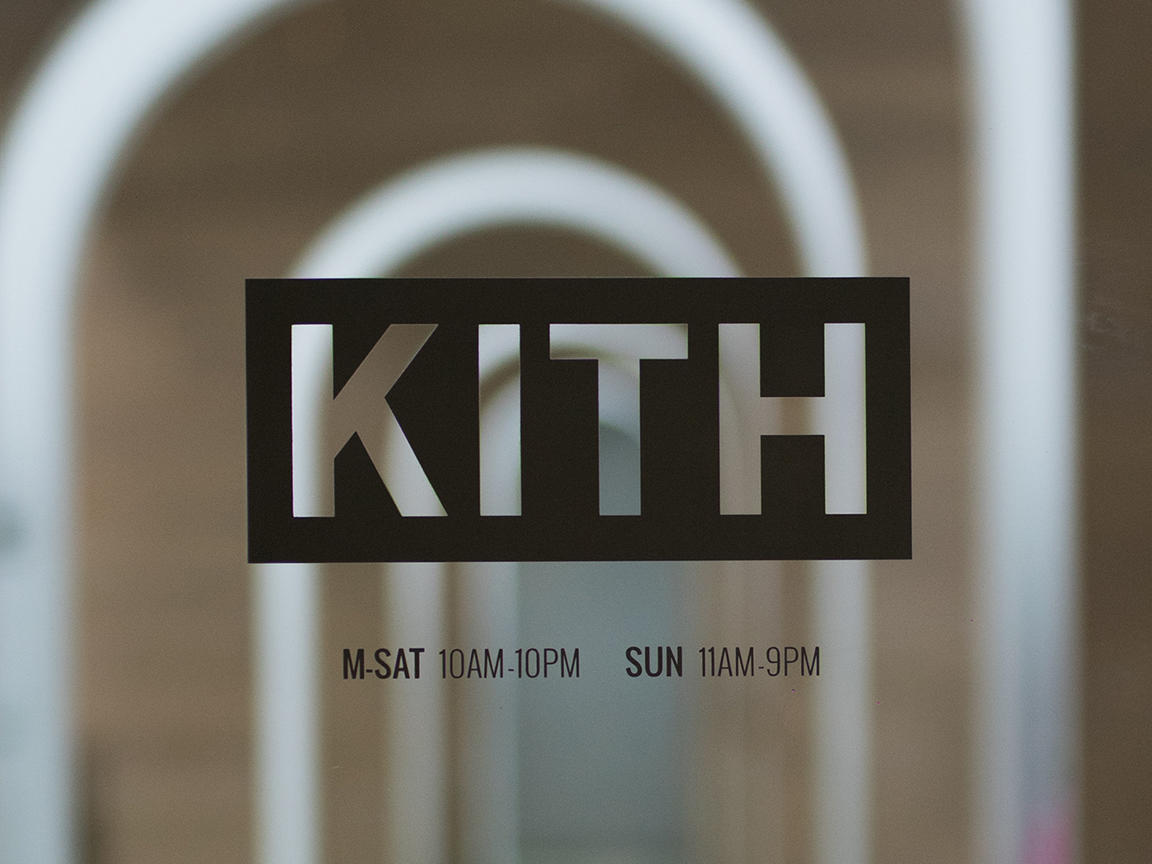 kith logo on glass door