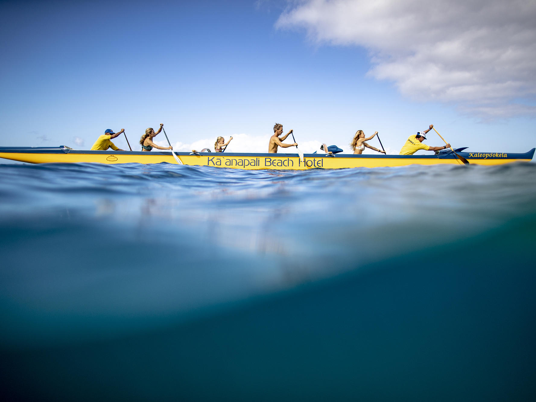 group of people paddling in canoe