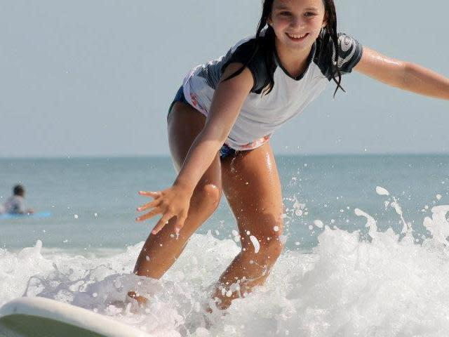 Young lady surfing.