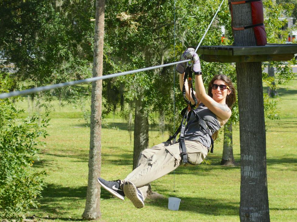 Happy individual ziplining.