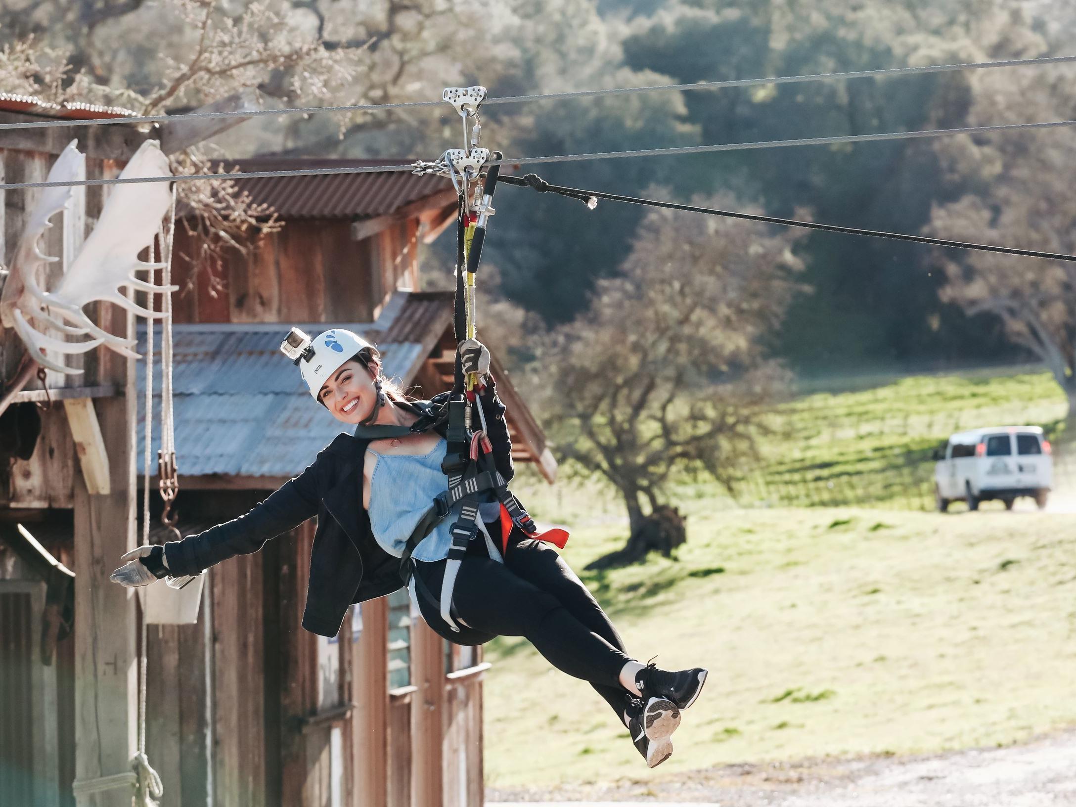 Girl ziplining with Margarita Adventures