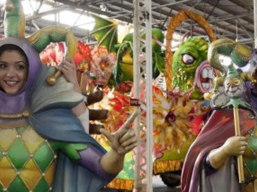 People in costumes at Mardi Gras World near the hotel