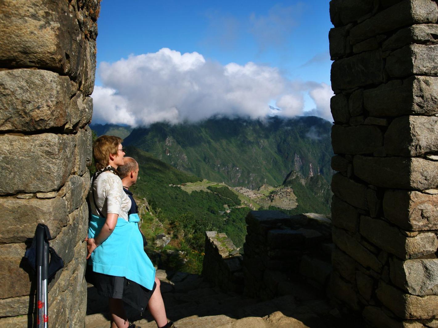 A couple admiring the view in The Sun Gate near Hotel Sumaq