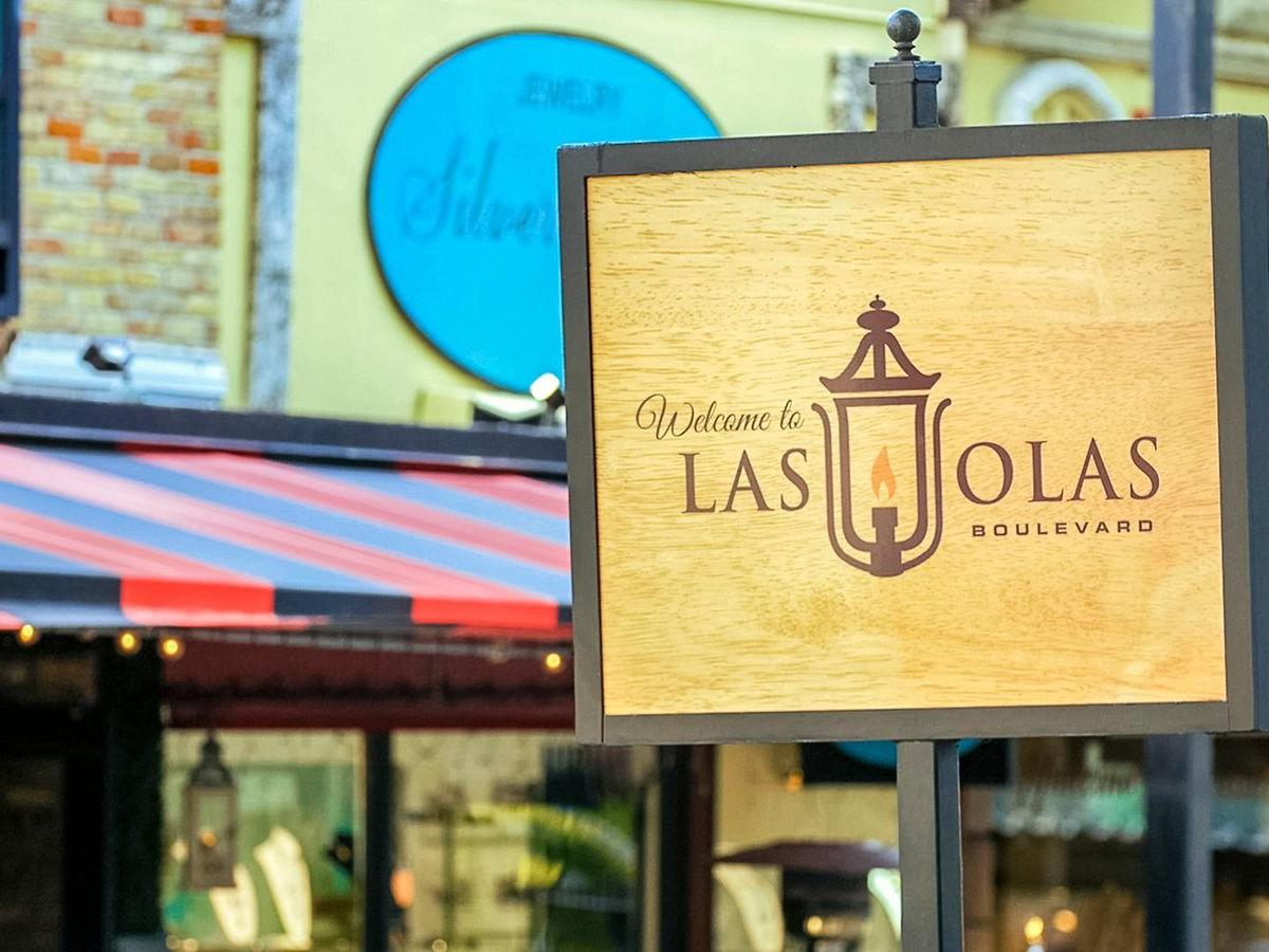 sign that says welcome to las olas boulevard