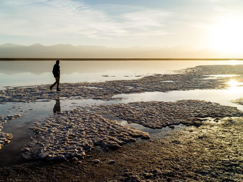 man walking in Cejar Lagoon near NOI Casa Atacama hotel