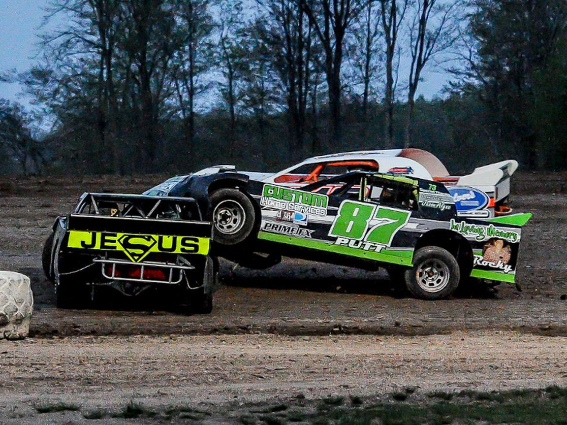 two speed cars driving on dirt track