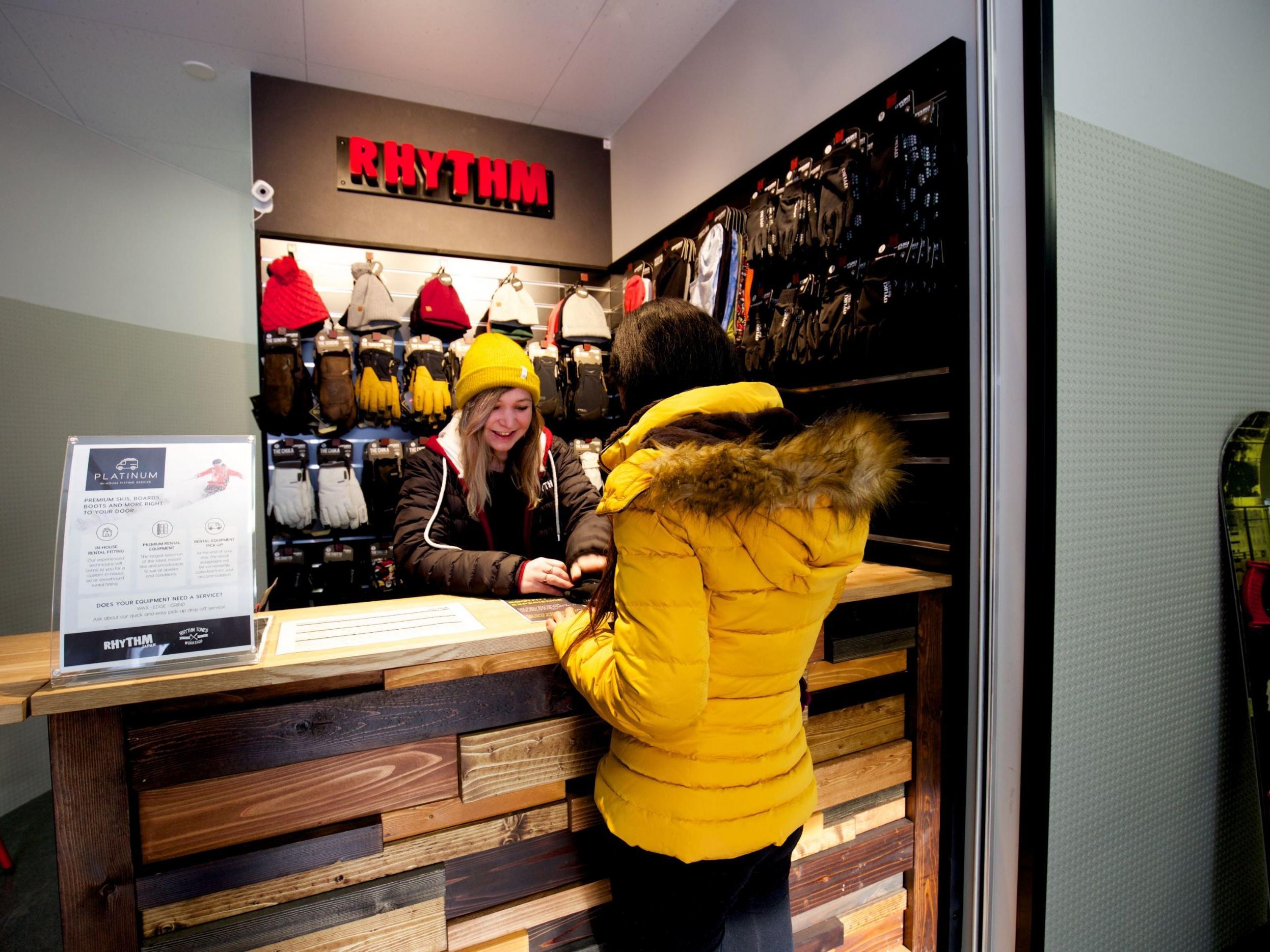 A girl buying equipment in Rhythm Service Counter Equipment rental near Chatrium Niseko Japan