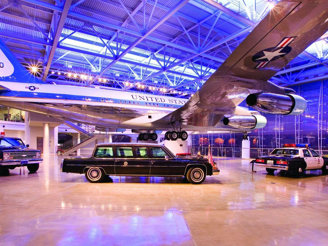 taxi car, police car and airplane at museum