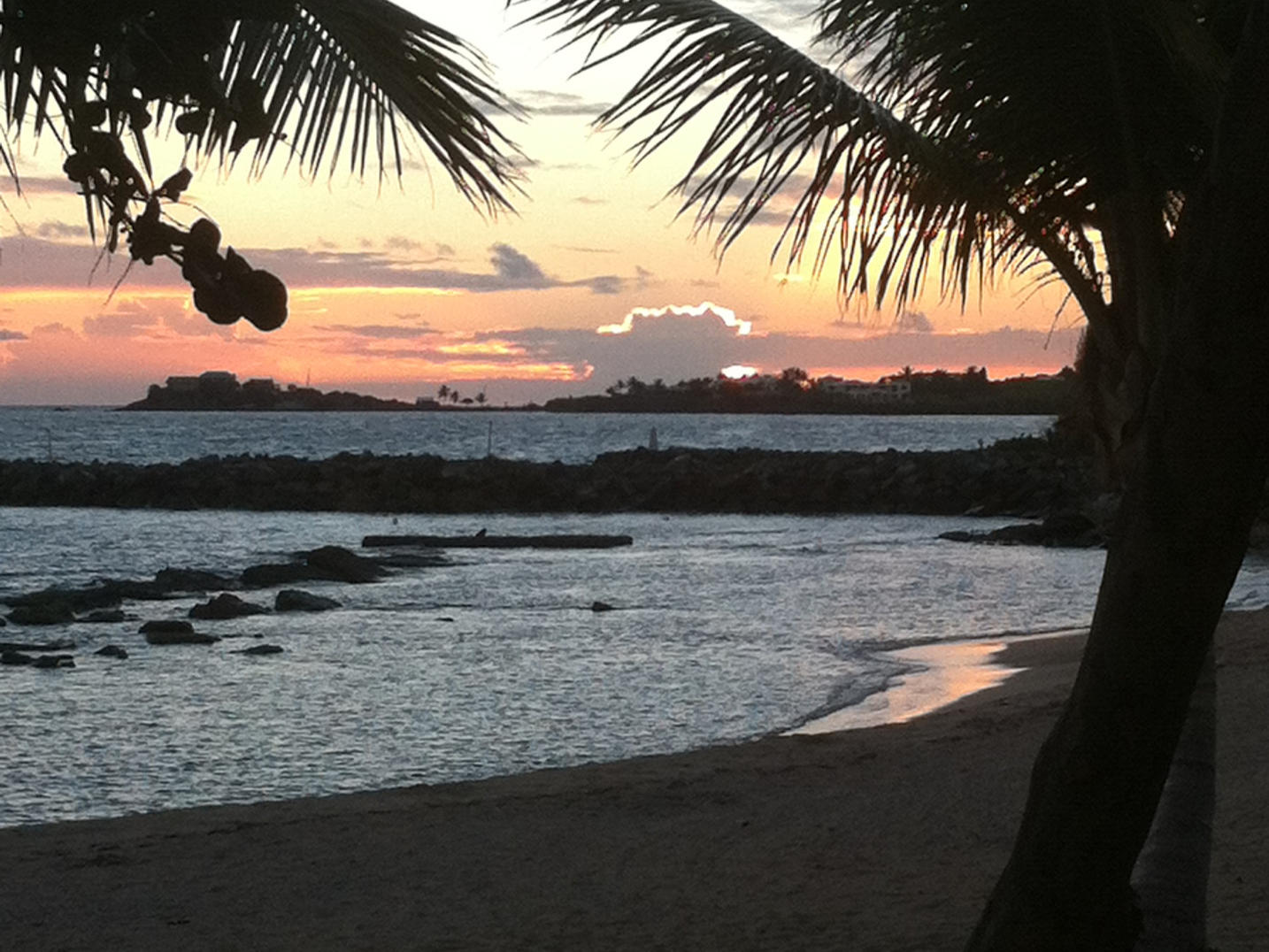 Sunset on beach at Tamarind Reef Resort