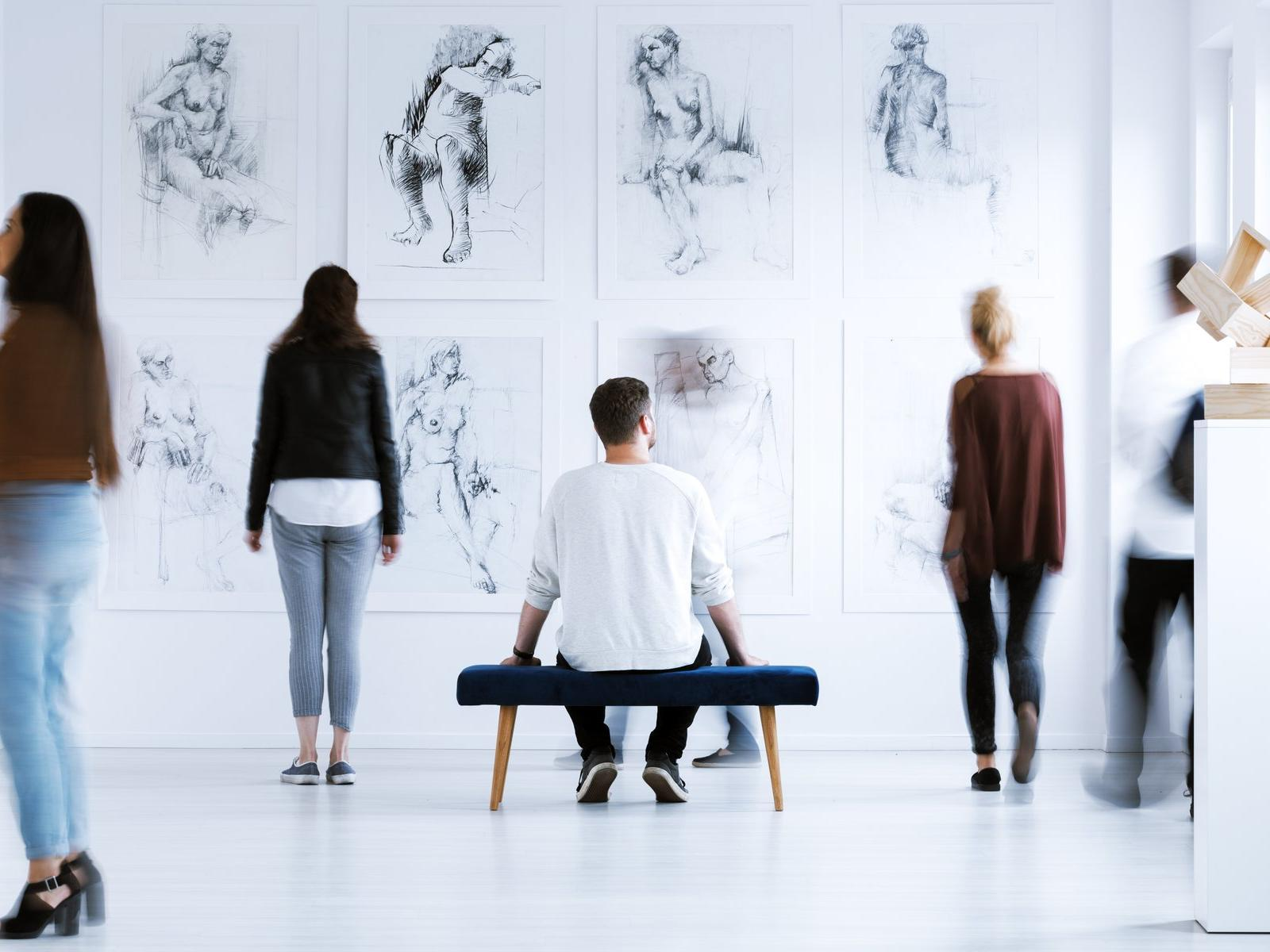people observing art in a gallery