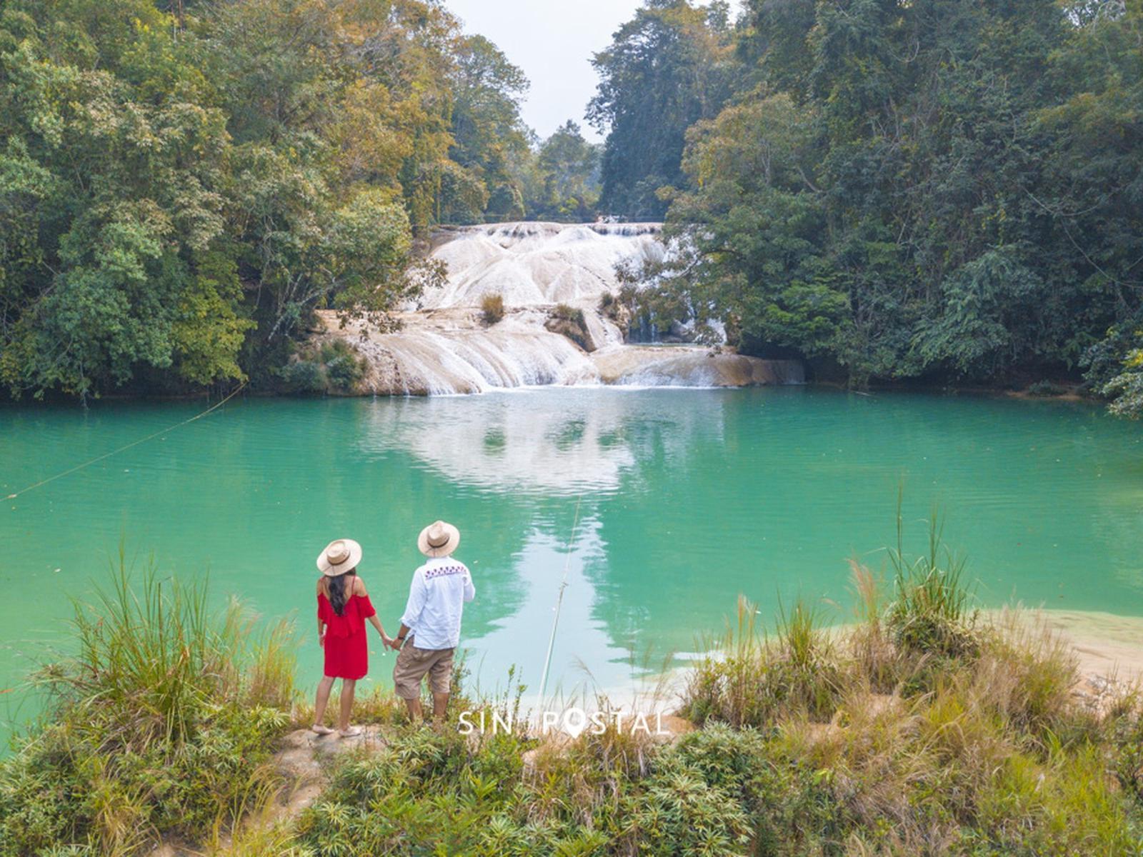 a couple watching a waterfall