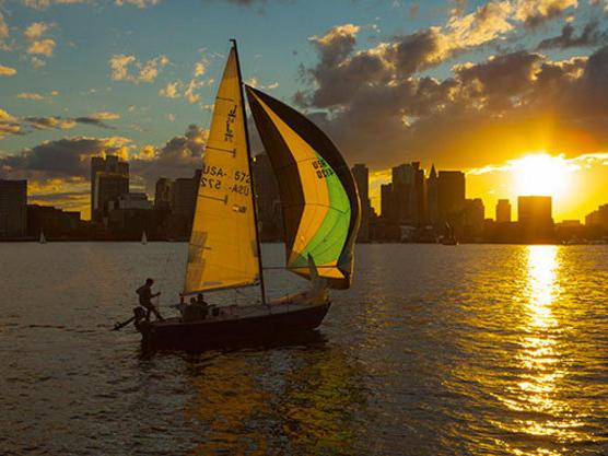 a person sailing a sail boat