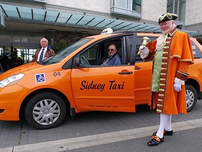 men standing by a sidney taxi