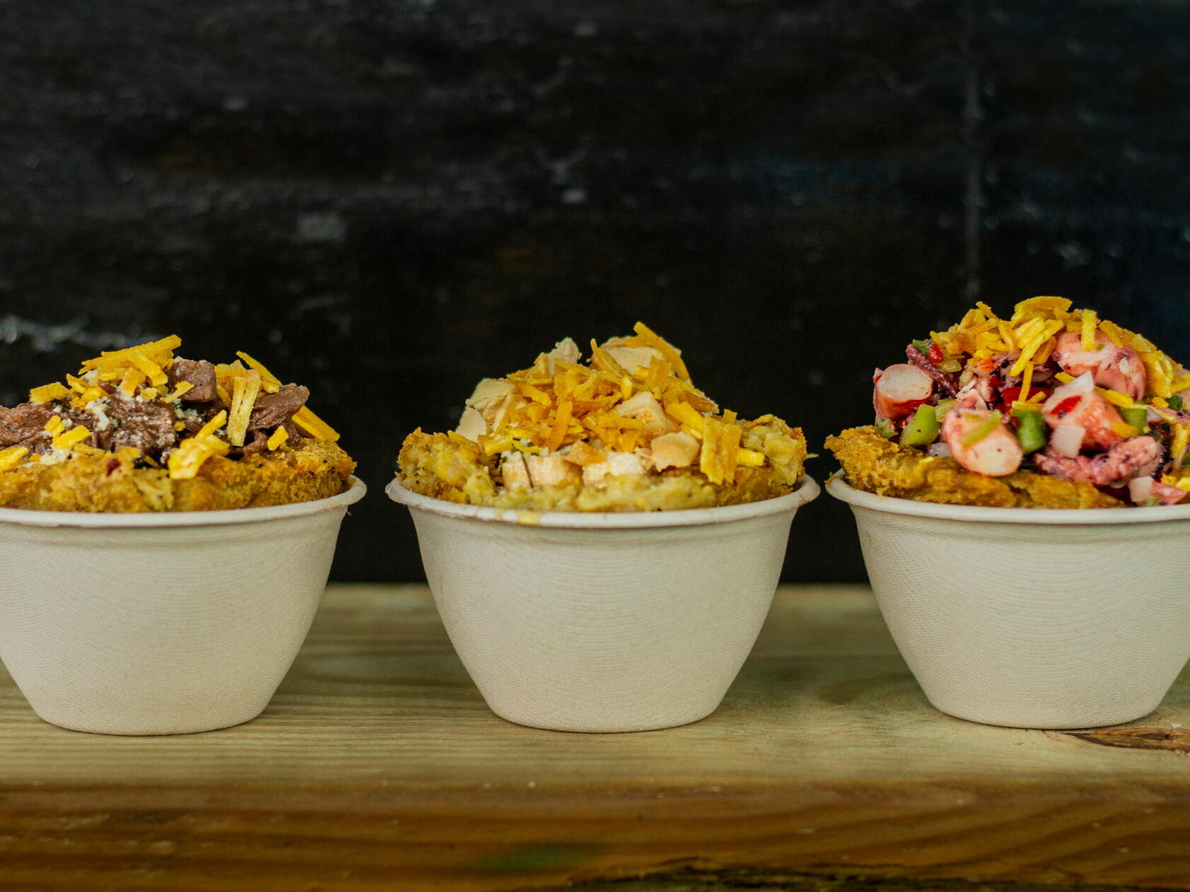 three bowls over-flowing with food