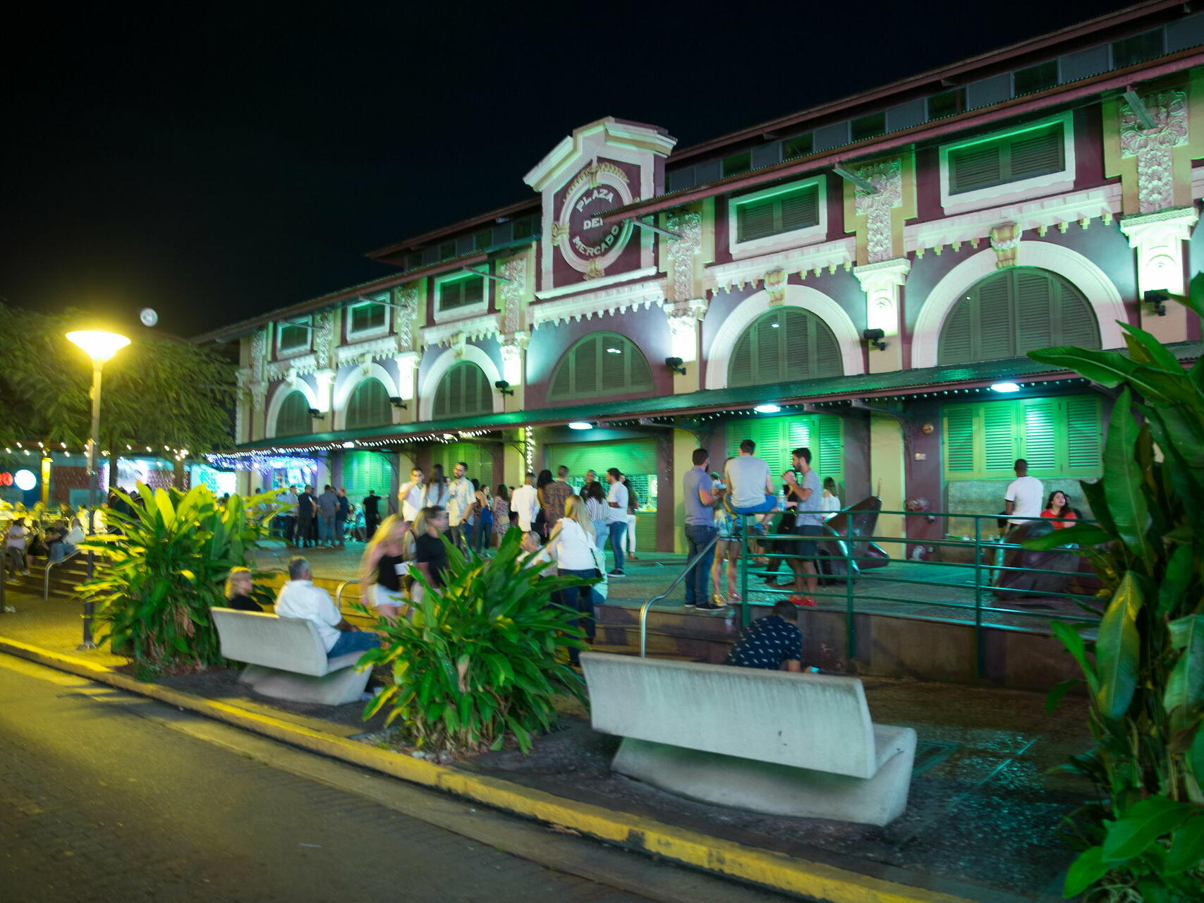 plaza with people hanging out at night