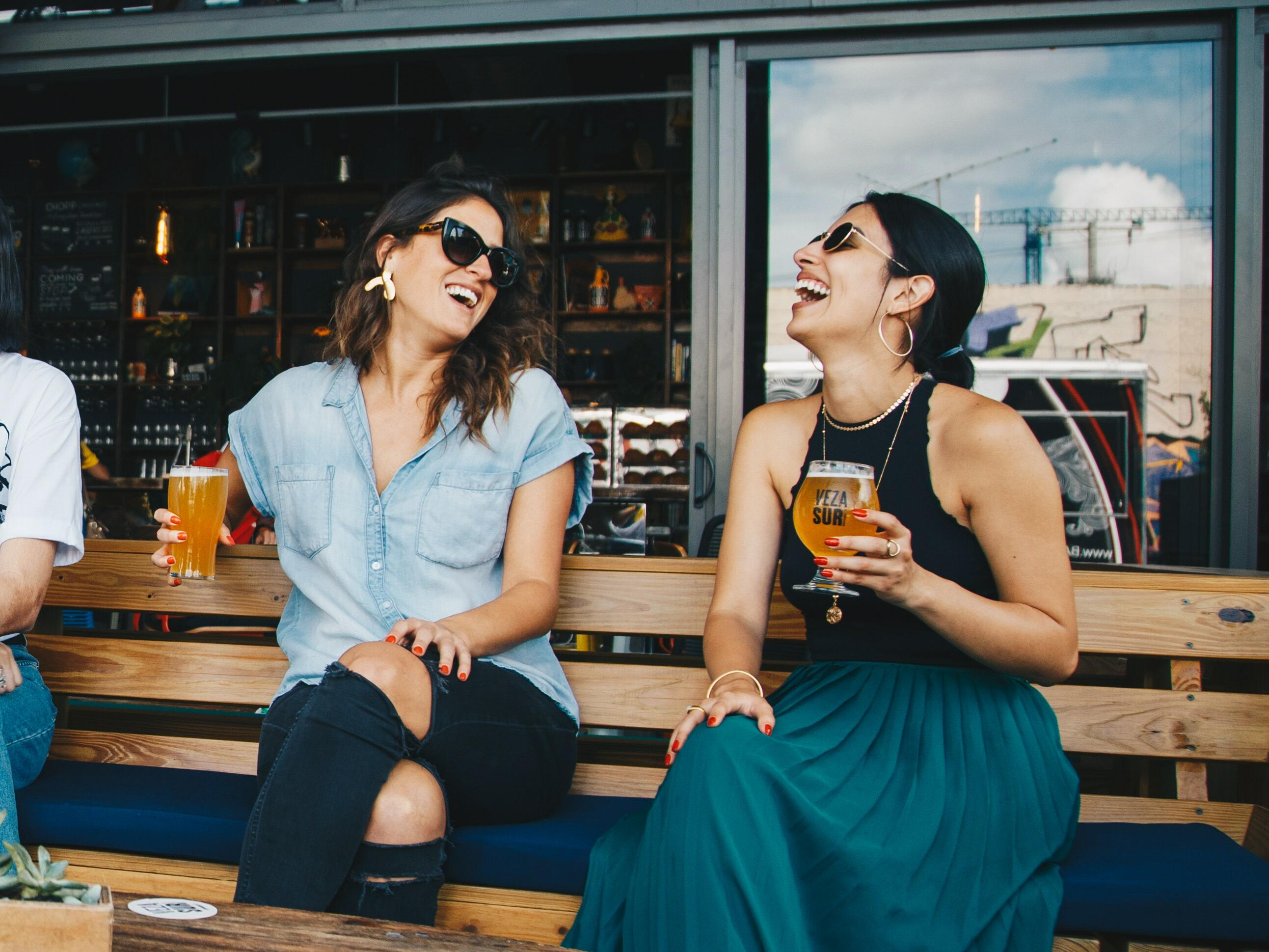 ladies laughing drinking beer