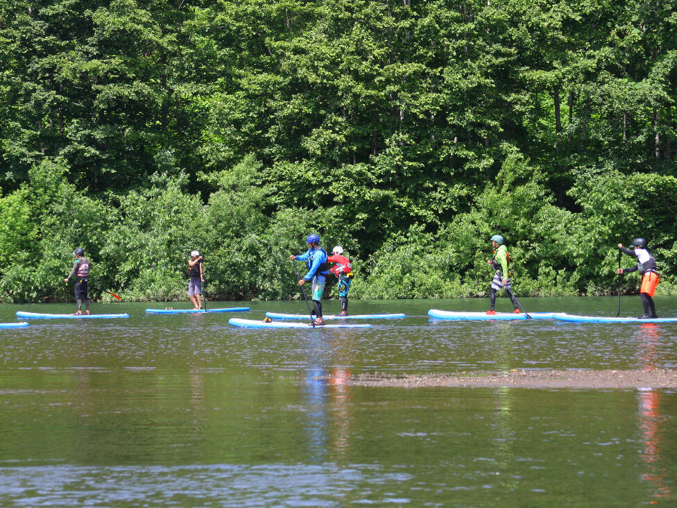Stand up paddle in the Shiribetsu river near Chatrium Niseko Japan