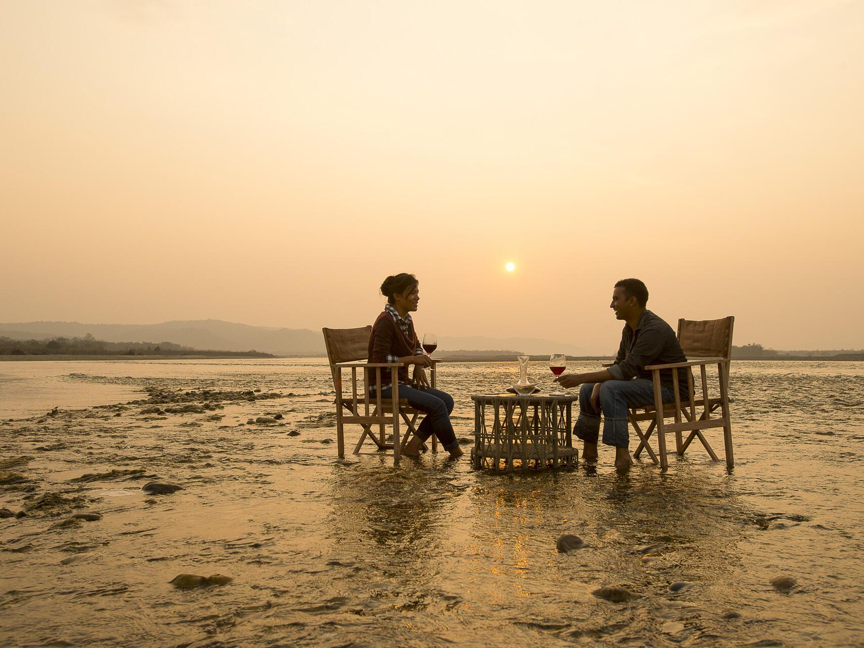 Men sitiing on the chairs at beach near  Meghauli Serai