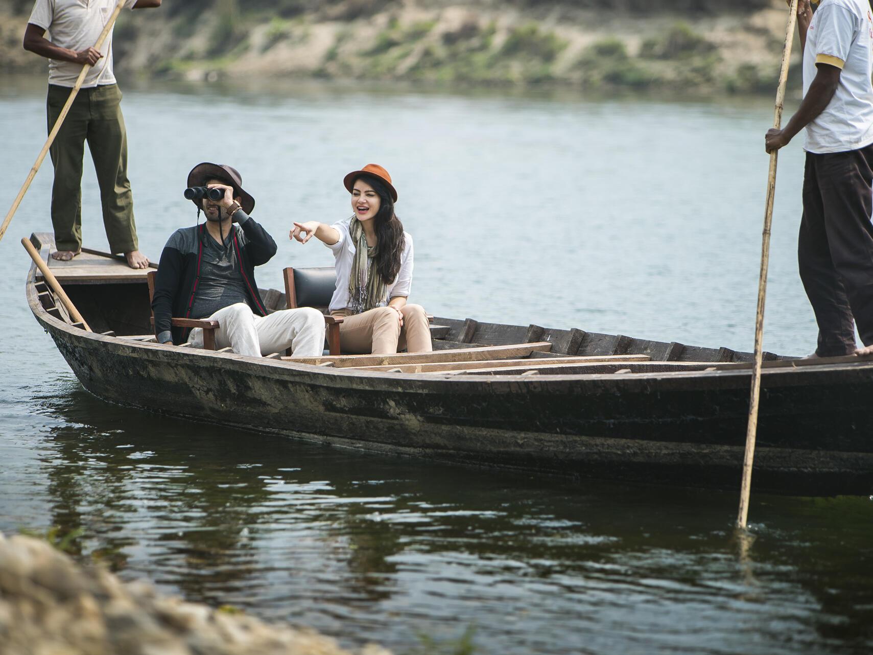 The couple enjoying river by boat safari  at Meghauli Serai